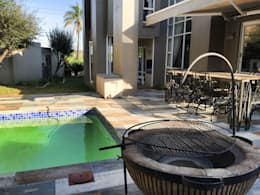 New Pool and Patio - view from the fire pit:  Patios by Acton Gardens