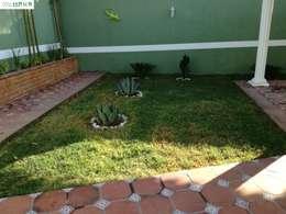 Área Verde: Jardines de estilo rústico por OmaHaus Arquitectos