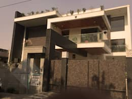 KIRTI BHAWAN: modern Houses by APT Designs