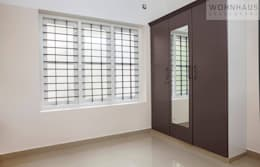 1400sqft House in Trivandrum: modern Bedroom by Wohnhaus Developers