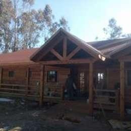 casa campo: Casas de estilo rural por construcciones costa