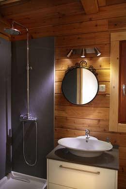 Baños de estilo rústico de Rusticasa