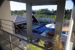 área de Lazer: Casas familiares  por MORSCH WILKINSON arquitetura
