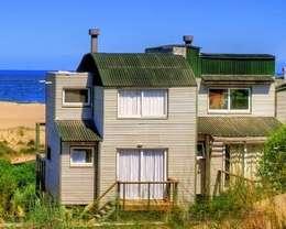 La Amistad Cottages: Casas geminadas  por Studio Defferrari