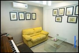 ESTUDIO: Estudios y oficinas de estilo minimalista por SEZIONE