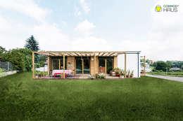 Nhà gia đình by COMMOD-Haus GmbH