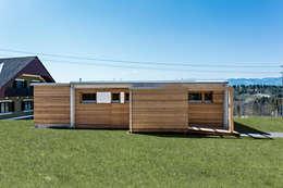 Casas prefabricadas de estilo  por COMMOD-Haus GmbH