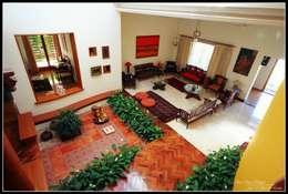 Temple Bells - Arati and Sundaresh's Residence: eclectic Living room by Sandarbh Design Studio