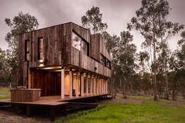 Cabañas de madera de estilo  por Dx Arquitectos