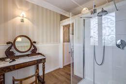 Baños de estilo clásico por Studio Guerra Sas