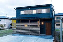 Casas de madera de estilo  por 株式会社山口工務店