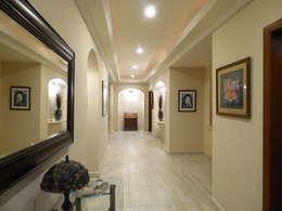 Vestibule : Salas de estilo moderno por DHI Arquitectos y Constructores de la Riviera Maya