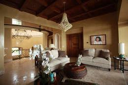Salas de estar  por DHI Riviera Maya Architects & Contractors