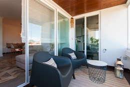Balcones y terrazas de estilo  por Traço Magenta - Design de Interiores