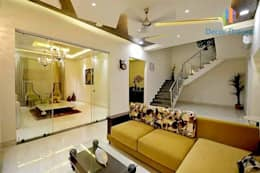 Independent Bungalow - Mr. Modi: scandinavian Living room by DECOR DREAMS