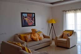L&T South city, 3 BHK - Mr. Sundaresh: mediterranean Living room by DECOR DREAMS