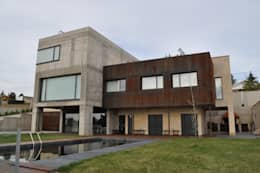Villas de estilo  por URBAQ arquitectos s.l.