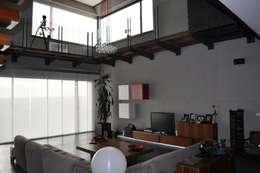 Salas de estilo minimalista por URBAQ arquitectos s.l.