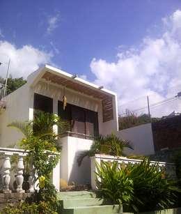 fachada: Casas de estilo ecléctico por Bello diseño interior