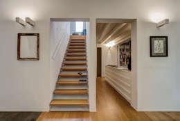 Casa ADP, ristrutturazione a padova: Ingresso & Corridoio in stile  di depaolidefranceschibaldan architetti