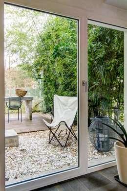 Casa ADP, ristrutturazione a padova: Giardino in stile in stile Moderno di depaolidefranceschibaldan architetti