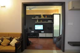 2 BHK APARTMENT INTERIORS IN BANGALORE: modern Media room by BENCHMARK DESIGNS