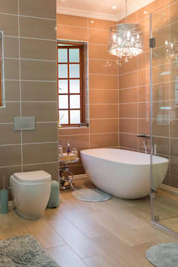 Contemporary meets African accents : minimalistic Bathroom by Indoni Interiors