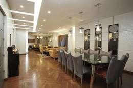 Dokki Apartment:  غرفة السفرة تنفيذ Hazem Hassan Designs