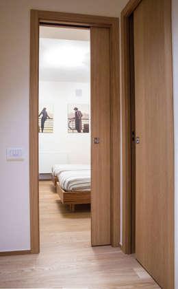 أبواب منزلقة تنفيذ Scrigno S.p.A. Unipersonale