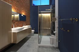 Industrial style apartment: industrial Bathroom by AT The Studio