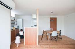 西ヶ崎町の家: 横山浩之建築設計事務所が手掛けたダイニングです。