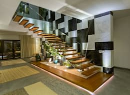 Pasillos y recibidores de estilo  por Grid Fine Finishes