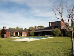 Casa de campo: Jardines de estilo rural por Marcelo Manzán Arquitecto