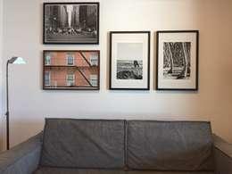 Detalhe sofá | Quadros: Salas multimídia modernas por branco arquitetura