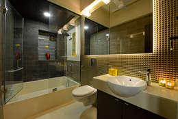 Matunga Apartment: modern Bathroom by Fourth Axis Designs