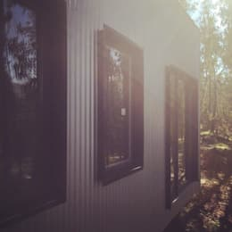 CASA TUCA: Casas prefabricadas de estilo  por ERKSTUDIO
