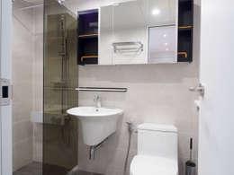 Baños de estilo moderno por 달달하우스