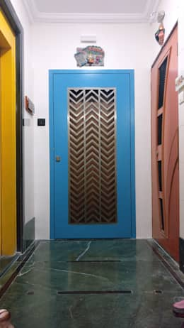 Mahim Residence got a blue touch:  Doors by Olive Roof