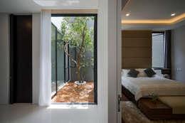 Jardines zen de estilo  por Simple Projects Architecture