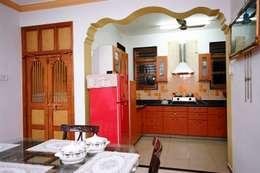 Kitchen and Puja Ghar:  Kitchen by Spacecraftt Architects