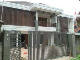 Casas de estilo topical por PT.Matabangun Kreatama Indonesia