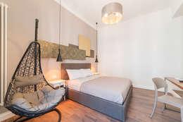 Dormitorios de estilo ecléctico de cristina bisà
