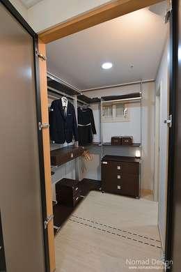 부산 호텔을 컨셉으로한 24평 아파트: 노마드디자인 / Nomad design의  전시장