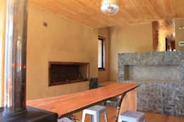 Casa de Fardos: Comedores de estilo rústico por Kimche Arquitectos