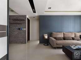 沙發牆:  牆面 by 禾廊室內設計