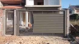 Puertas principales de estilo  por Dartora Esquadrias Metálicas