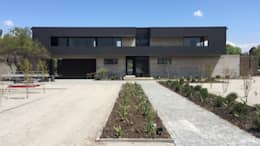 Casa DLP: Casas de estilo moderno por 2712 / asociados