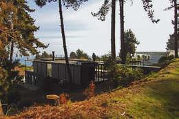 Casa Pati O: Casas de madera de estilo  por 2712 / asociados