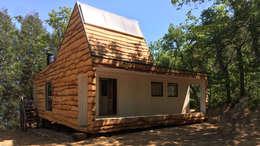 Cabaña de las Chimeneas de Luz: Cabañas de estilo  por 2712 / asociados
