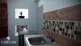 DEPARTAMENTO CA5 en 25m2: Muebles de cocinas de estilo  por CLAROSCURO ESTUDIO DE ARQUITECTURA